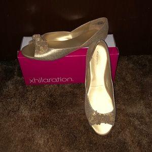 Metallic gold peep toe flats